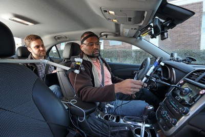 A University of Utah research assistant introduces a participant in new distracted driving studies to special devices designed to gauge mental distraction during road tests. Image credit: AAA Foundation for Traffic Safety