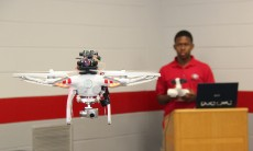 Undergraduate research assistant Julian Moore pilots a specially outfitted drone inside the Driftmier Engineering Center. Image credit: Mike Wooten/UGA
