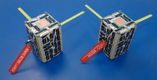 Two of the assembled Edison Demonstration of Smallsat Networks (EDSN) mission satellites. Small, but each nanosatellite is packed with high-tech hardware that can perform a top-notch scientific task. Credits: NASA