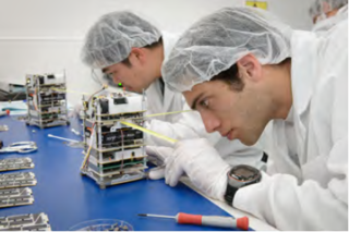 Spacecraft specialists prepare spacecraft to perform the Edison Demonstration of Smallsat Networks (EDSN) mission. Credits: NASA