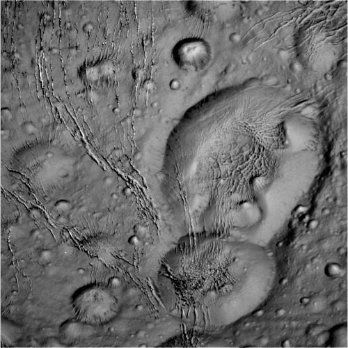 Craters near Enceladus' north pole region appear to be 'melting' into each other. Image taken by Cassini spacecraft on October 14, 2015. Credit: NASA/JPL-Caltech/Space Science Institute