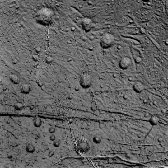 Craters and fractures dot the landscape of the northern region of Enceladus in this raw image from the Cassini spacecraft taken on October 14, 2015. Credit: NASA/JPL-Caltech/Space Science Institute.