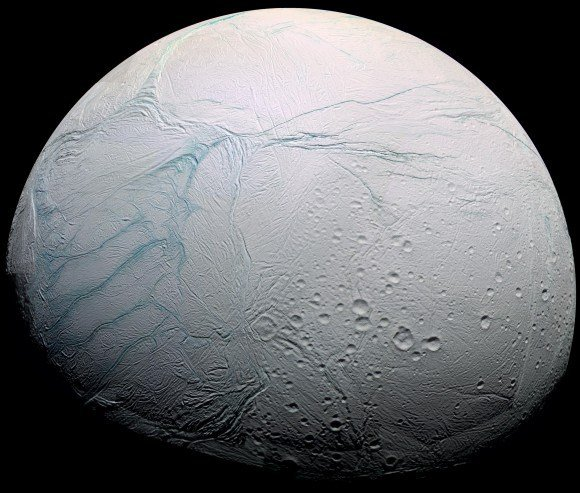 """Image of Saturn's Enceladus taken by the Cassini spacecraft in 2009, showing both cratered surfaces and the mysterious """"Tiger Stripes"""". Credit: NASA/JPL/ESA/SSI"""