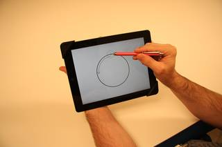 This touchscreen shows an example of one of the Fine Motor Skills investigation tasks: Circle Tracing with Stylus. Credits: NASA