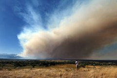 A view of a wildfire burning in the Four Mile Canyon area west of Boulder from an overlook in Louisville, Colorado on September 6, 2010. Image credit: Glenn Asakawa/University of Colorado