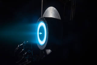 An ion propulsion system is test-fired at NASA's Glenn Research Center in Cleveland. Credits: NASA/GRC/Christopher J. Lynch