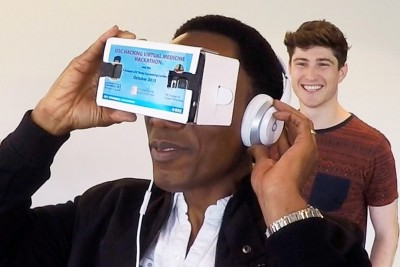 Lloyd Green tries out a team's virtual reality health care solution. Photo credit: Jay Iorio