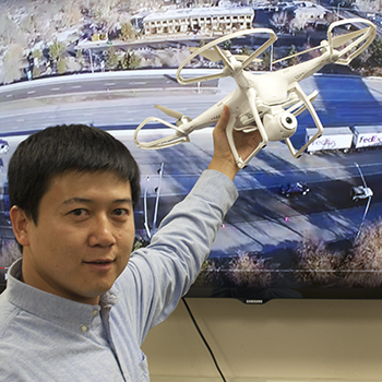 Professor Hao Xu uses technological gadgets, such as drones, to research ways to improve traffic safety while working with groups at the University, such as NAASIC and SOLARIS.