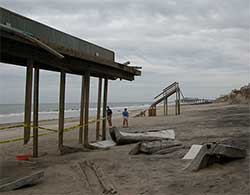 USGS coastal scientists visit Nags Head in the Outer Banks to examine coastal erosion impacts that occurred from Hurricane Isabel in 2003.