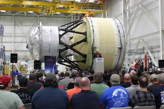 Space Launch System Program Manager John Honeycutt thanks United Launch Alliance (ULA) and Boeing Co. employees for their work on the completed interim cryogenic propulsion stage (ICPS) test article during a media event Oct. 26 at ULA's facility in Decatur, Alabama. The ICPS is the liquid oxygen/liquid hydrogen-based system that will give Orion the big, in-space push needed on that mission to fly beyond the moon before it returns to Earth. Credits: ULA