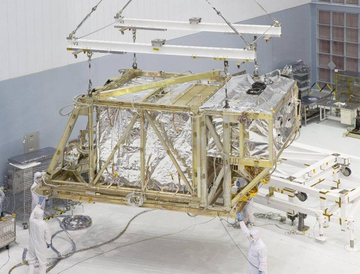 The James Webb Space Telescope team lifts the Integrated Science Instrument Module (ISIM) structure by crane as it leaves the Goddard clean room for the thermal vacuum chamber. Credits: NASA/Chris Gunn