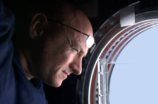 Astronaut Scott Kelly watches the Earth go by from a cupola window. Isolation and confinement is a condition of expeditions to the space station. Journaling is one way to combat some of the effects. Credits: NASA