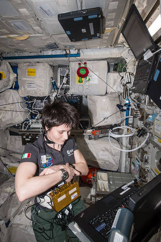 Samantha Cristoforetti conducts plethysmography and pulmonary function system measurements during Brain Drain investigation operations during Expedition 42 aboard the International Space Station. Credits: NASA