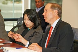 Jetta Wong of the U.S. Department of Energy's Office of Technology Transitions confers with U.S. Sen. Tom Udall, D-N.M., at a technology transfer roundtable in the Sandia Science & Technology Park in Albuquerque. Wong told local business owners the office is working to expand the commercial impact of national laboratory research and development.