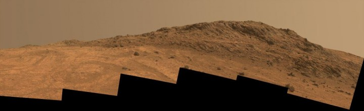 """'Hinners Point' Above Floor of 'Marathon Valley' on Mars. This Martian scene shows contrasting textures and colors of """"Hinners Point,"""" at the northern edge of """"Marathon Valley,"""" and swirling reddish zones on the valley floor to the left. Credit: NASA/JPL-Caltech/Cornell Univ./Arizona State Univ."""