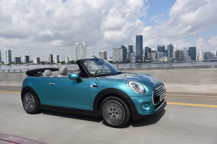 The new MINI Convertible may be bigger and more practical than before, but it retained classic MINI features and is easily recognizable across the globe. New Caribbean Aqua metallic finish fits car nicely as well. Image credit: press.bmwgroup.com