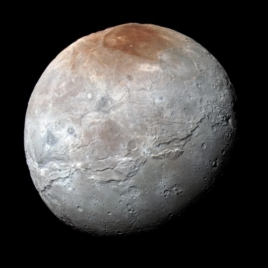 Charon in Enhanced Color with Grand Canyon NASA's New Horizons captured this high-resolution enhanced color view of Charon and its Grand Canyon just before closest approach on July 14, 2015. The image combines blue, red and infrared images taken by the spacecraft's Ralph/Multispectral Visual Imaging Camera (MVIC); the colors are processed to best highlight the variation of surface properties across Charon. Charon's color palette is not as diverse as Pluto's; most striking is the reddish north (top) polar region, informally named Mordor Macula. Charon is 754 miles (1,214 kilometers) across; this image resolves details as small as 1.8 miles (2.9 kilometers). Credits: NASA/JHUAPL/SwRI