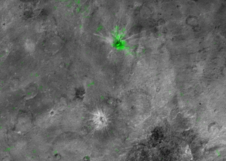 Charon's Young Ammonia Crater. The informally named Organa crater (shown in green) is rich in frozen ammonia and – so far – appears to be unique on Pluto's largest moon. Credits: NASA/JHUAPL/SwRI