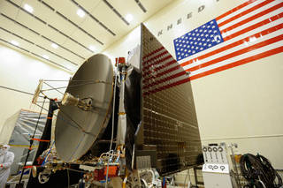 The high gain antenna and solar arrays were installed on the OSIRIS-REx spacecraft prior to it moving to environmental testing. Credits: Lockheed Martin Corporation