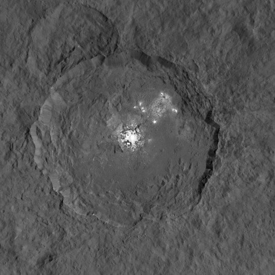 This image, made using images taken by NASA's Dawn spacecraft during the mission's High Altitude Mapping Orbit (HAMO) phase, shows Occator crater on Ceres, home to a collection of intriguing bright spots. Credits: NASA/JPL-Caltech/UCLA/MPS/DLR/IDA