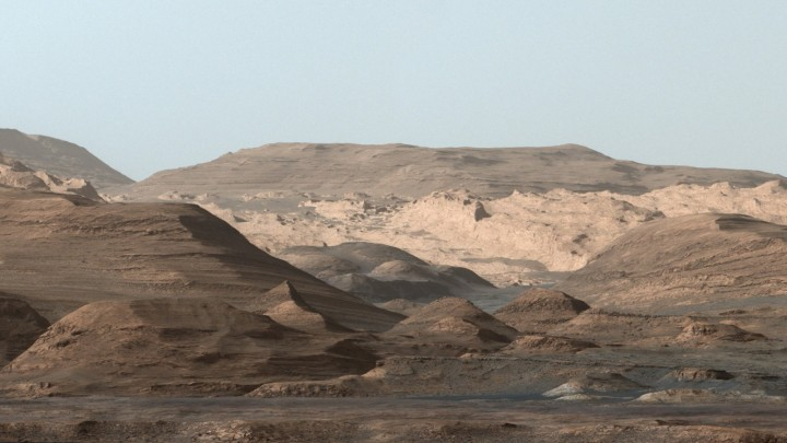 This composite image looking toward the higher regions of Mount Sharp was taken on September 9, 2015, by NASA's Curiosity rover. In the foreground -- about 2 miles (3 kilometers) from the rover -- is a long ridge teeming with hematite, an iron oxide. Credits: NASA/JPL-Caltech/MSSS