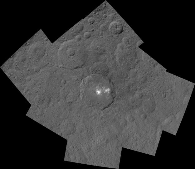 This mosaic shows Ceres' Occator crater and surrounding terrain from an altitude of 915 miles (1,470 kilometers), as seen by NASA's Dawn spacecraft. Occator is about 60 miles (90 kilometers) across and 2 miles (4 kilometers) deep. Credits: NASA/JPL-Caltech/UCLA/MPS/DLR/IDA
