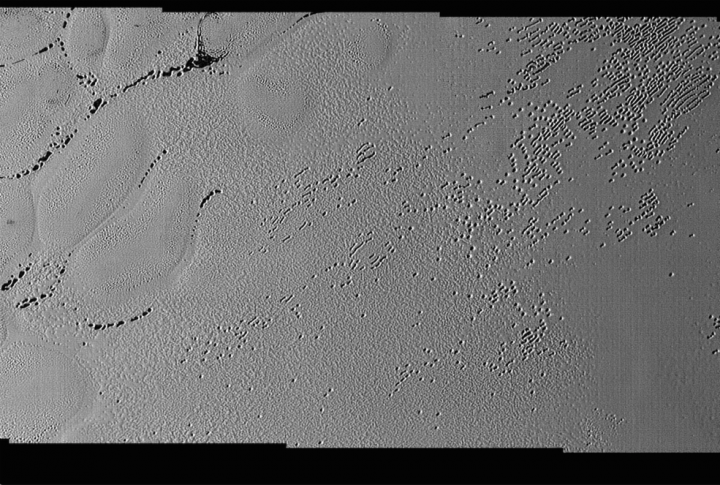 Pluto's Puzzling Patterns and Pits