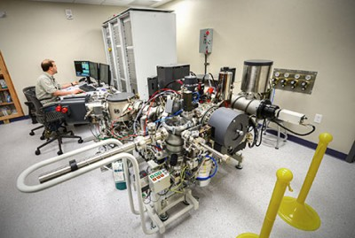 Fike at the console of the SIMS instrument, originally designed for geological specimens, that will be upgraded for use on biological ones. Image credit: James Byard