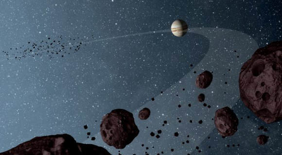 """Artist's concept of Jupiter's Trojan asteroids hovering in the foreground in Jupiter's path, with the """"Greeks"""" at left in the background. Credit: NASA."""