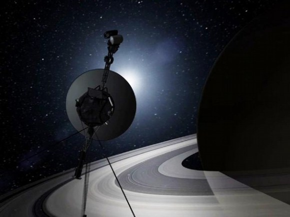 Artist's impression of Voyager 1 reaching Saturn and its system of moons. Image Credit: NASA/JPL – Caltech