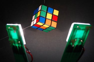 This image of single-doped organic light-emitting diodes (OLEDs) shining a high-quality white light on a Magic Cube shows how OLEDs can vividly illuminate the colors of the cube across the full range of the visible color spectrum from blue to green, yellow and red. ASU engineer Jian Li's research team is working to develop a cost-effective solution for the next generation of solid-state lighting products based on OLED technologies. Photo courtesy of Jian Li's research group.