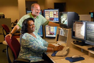 Before moving to their current roles, Lybrease Woodard and Joey Pirani tested computer systems that simulate International Space Station operations in 2010. The simulations prepare flight controllers and other team members who work with space crews to conduct complex experiments. Credits: NASA