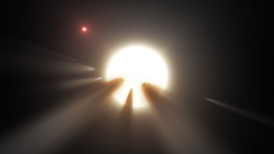 This illustration shows a star behind a shattered comet. Observations of the star KIC 8462852 by NASA's Kepler and Spitzer space telescopes suggest that its unusual light signals are likely from dusty comet fragments, which blocked the light of the star as they passed in front of it in 2011 and 2013. The comets are thought to be traveling around the star in a very long, eccentric orbit. Image credit: NASA/JPL-Caltech.
