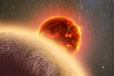 In this artist's rendering of GJ 1132b, a rocky exoplanet very similar to Earth in size and mass, circles a red dwarf star. GJ 1132b is relatively cool (about 450 degrees F) and could potentially host an atmosphere. At a distance of only 39 light-years, it will be a prime target for additional study with Hubble and future observatories like the Giant Magellan Telescope. Image credit: Dana Berry