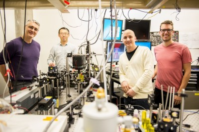 This instrument built by UW engineers (from left) Peter Pauzauskie, Xuezhe Zhou, Bennett Smith, Matthew Crane and Paden Roder (unpictured) used infrared laser light to refrigerate liquids for the first time. Image credit: Dennis Wise/University of Washington