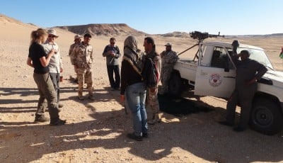 Above, armed guards accompanied researchers during their dangerous Libyan fieldwork. Photo courtesy of the researchers.