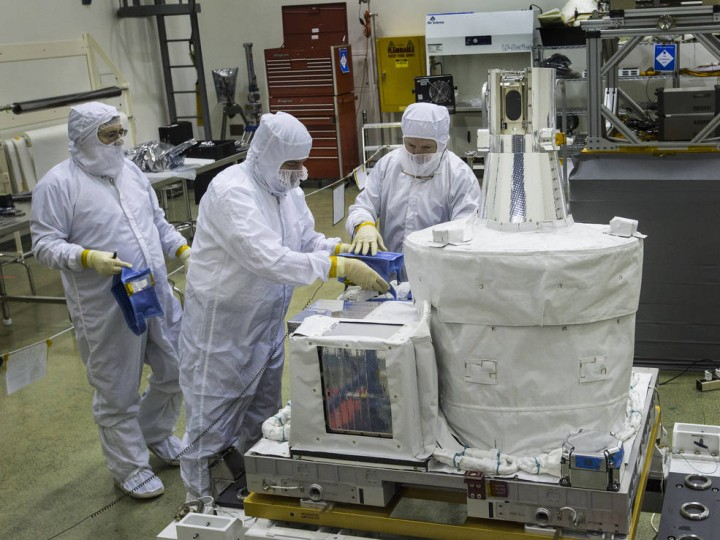 Technicians inside a clean room at NASA's Langley Research Center work on the SAGE III instrument, preparing it to ship to NASA's Kennedy Space Center for launch to the International Space Station. The ozone- and aerosol-measuring instrument is the latest in a long line of atmospheric science experiments designed at NASA Langley. Credits: NASA/David C. Bowman