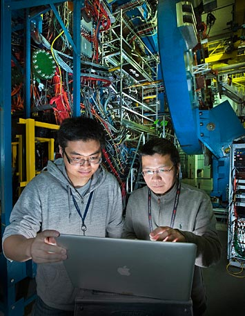 Zhengqiao Zhang, a graduate student from the Shanghai Institute of Applied Physics, with STAR physicist Aihong Tang at the STAR detector of the Relativistic Heavy Ion Collider (RHIC).