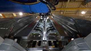 At NASA's Michoud Assembly Facility in New Orleans, engineers used large tooling structures to help them weld together Orion's cone panels using a process called friction-stir welding. Credits: NASA