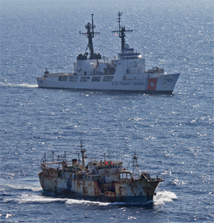 The crew of the Coast Guard Cutter Rush escorts the suspected high seas drift net fishing vessel Da Cheng in the North Pacific Ocean on August 14, 2012. Image credit: U.S. Coast Guard