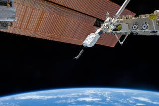 A large portion of commercial research aboard the station is made possible by NanoRacks hardware, a company that provides laboratory facilities for small payloads, like these cubesats deployed from the International Space Station. Credits: NASA