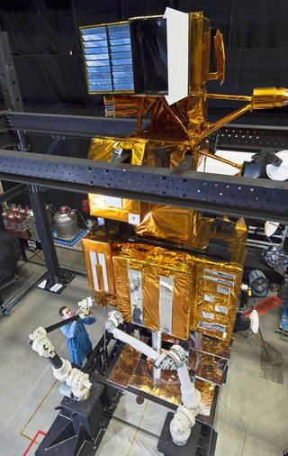 The Satellite Servicing Capabilities Office is developing technologies needed to repair and service satellites not originally designed for servicing. The organization uses laboratory equipment, such as this mockup of Landsat 7, to test the techniques. Credits: NASA/C. Gunn