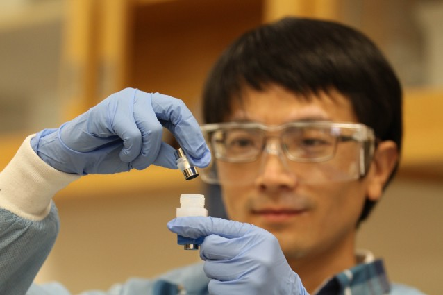 Jianchao Ye shows off an improved lithium ion battery.