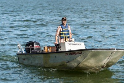 Luke Loken, a graduate student in the UW-Madison Center for Limnology, drives a boat around Lake Mendota as he uses a stern-mounted sensor — a device known as Fast Limnological Automated Measurement (FLAMe) — to collect real-time water sample data. Image credit: Jeff Miller
