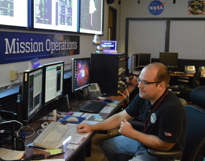Getting the data: Following the last in a series of four maneuvers targeting NASA's New Horizons spacecraft toward Kuiper Belt object 2014 MU69, flight controller George Lawrence monitors spacecraft data as it streams into the New Horizons Mission Operations Center at the Johns Hopkins University Applied Physics Laboratory on Nov. 4, 2015. Credits: NASA/JHUAPL/SwRI