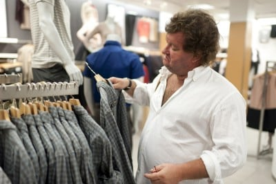 Mature man shopping for a shirt
