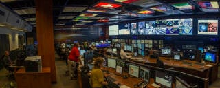 The Payload Operations Integration Center at Marshall is responsible for coordinating around-the-clock science operations on the International Space Station. The center was reconfigured and updated with new digital equipment in 2013. Credits: NASA/ MSFC/Emmett Given