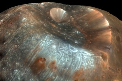 The Stickney crater at one end of Phobos was created by an impact that could have torn Phobos apart if the moon were less fractured and porous. NASA image, 2009.