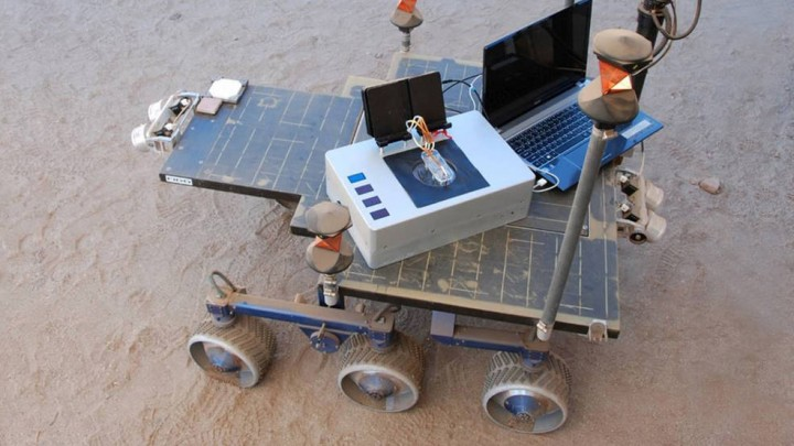 Researchers took the Chemical Laptop to JPL's Mars Yard, where they placed the device on a test rover. This image shows the size comparison between the Chemical Laptop and a regular laptop. Credits: NASA/JPL-Caltech