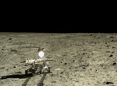 The Chinese lunar rover, Yutu, photographed by its lander Chang'e-3, after the lander touched down in Mare Imbrium, a giant impact basin that had been filled by successive lava flows. Image credit: CNAS/CLEP